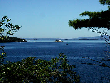 Our spectacular view of Pumpkin Island's Lighthouse, Pond Island, Islesboro, and the Distant Camden Hills.